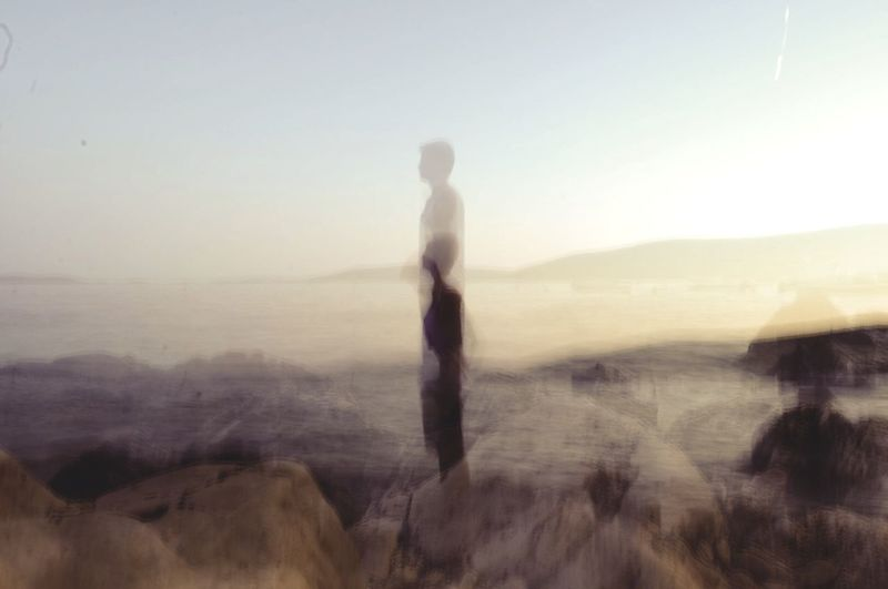Silhouette of woman standing on landscape