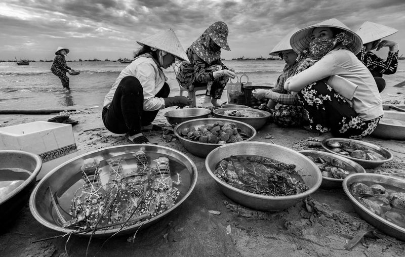Real People Water Sky Nature Women Day Adult People Cloud - Sky Occupation Working Lifestyles Food And Drink Beach Land Outdoors Fishing Industry Local Market Fishing Market Lobster Vietnam Mui Ne, Vietnam Fishing Village Sea Seafood Blackandwhite