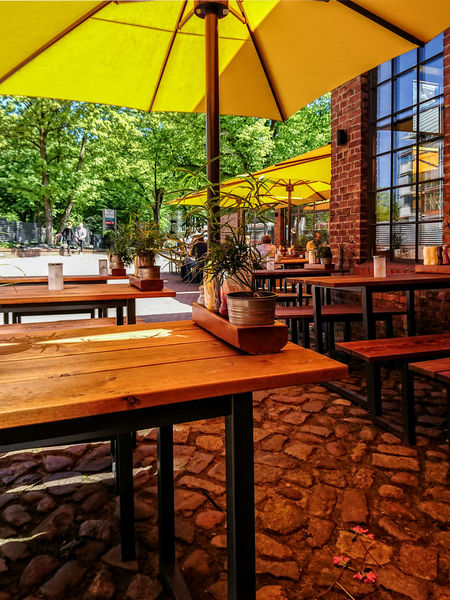outdoor restaurant Banks Chairs And Tables Eat And Drink Fabric Hamburg Handy Photo Old Building  Outdoor Restaurant Seats Sunshine Day Trees Winterhude Yellow Parasols