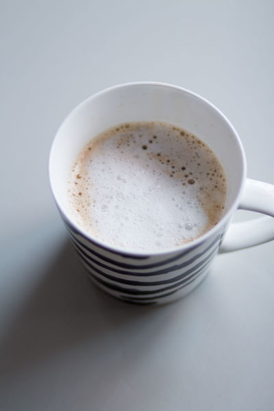 Breakfast Cafe Latte Close-up Coffee Coffee - Drink Coffee Cup Crockery Cup Drink Freshness Frothy Drink High Angle View Hot Drink Indoors  Mug No People Non-alcoholic Beverage Refreshment Still Life Studio Shot Table White Background