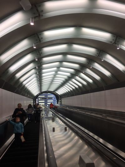 The City Light Real People Ceiling Indoors  Lifestyles Lighting Equipment Built Structure Subway Station Travel Illuminated Women Men Architecture Public Transportation Passenger Transportation Leisure Activity Large Group Of People Rail Transportation Subway Train Day
