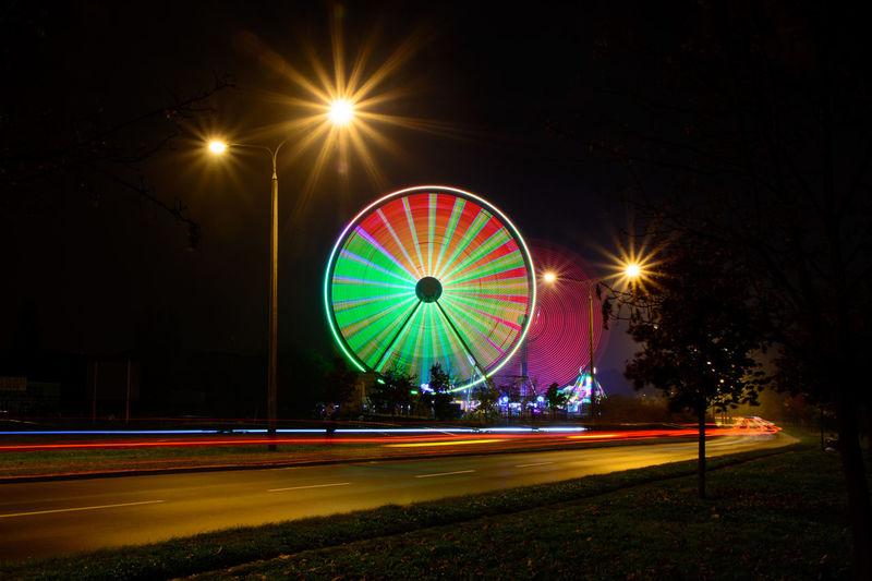 Amusement Park Ferris Wheel Illuminated Light Trail Long Exposure Motion Multi Colored Night Outdoors Street Light