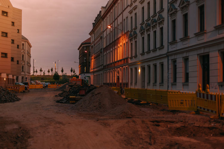 Road construction in residential neighborhood during sunset