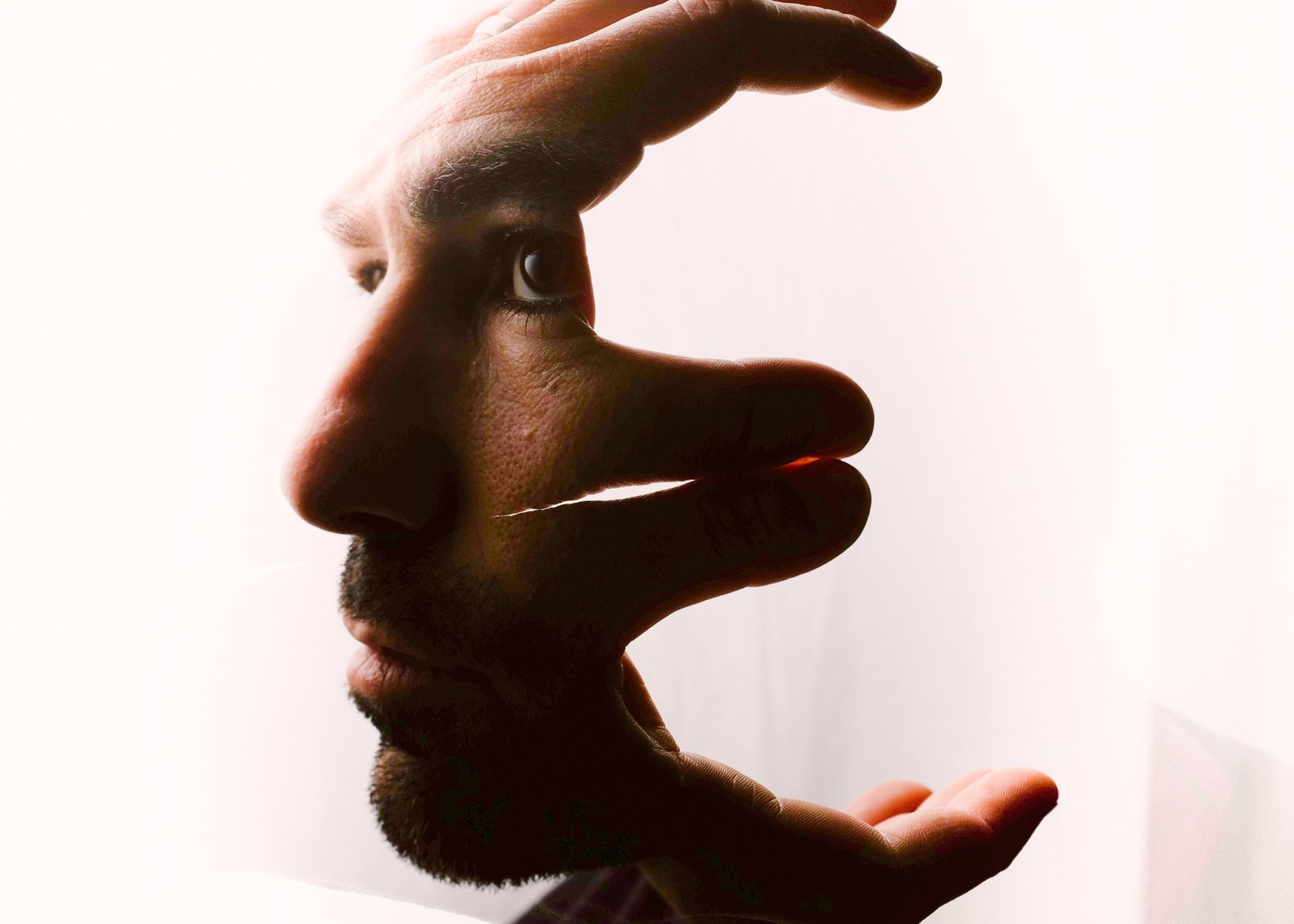 person, studio shot, white background, holding, lifestyles, copy space, part of, human finger, men, leisure activity, cropped, close-up, unrecognizable person, clear sky, indoors, cut out, standing