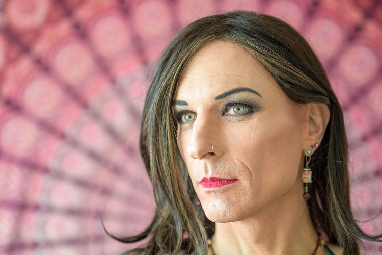 Close-up of mature transgender looking away