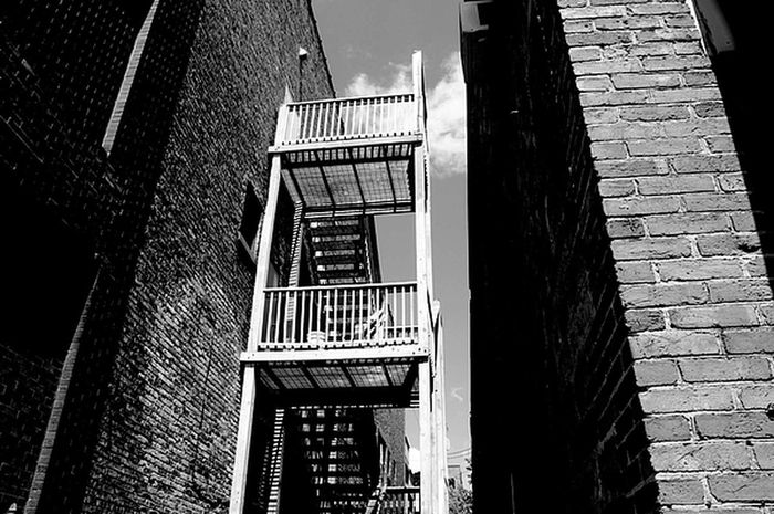 Alley B Black And White Building Exterior Clouds Fireescape Metal Stairs Staircase Stairs Street Photography The Street Photographer - 2016 EyeEm Awards The Architect - 2016 EyeEm Awards EyeEmNewHere