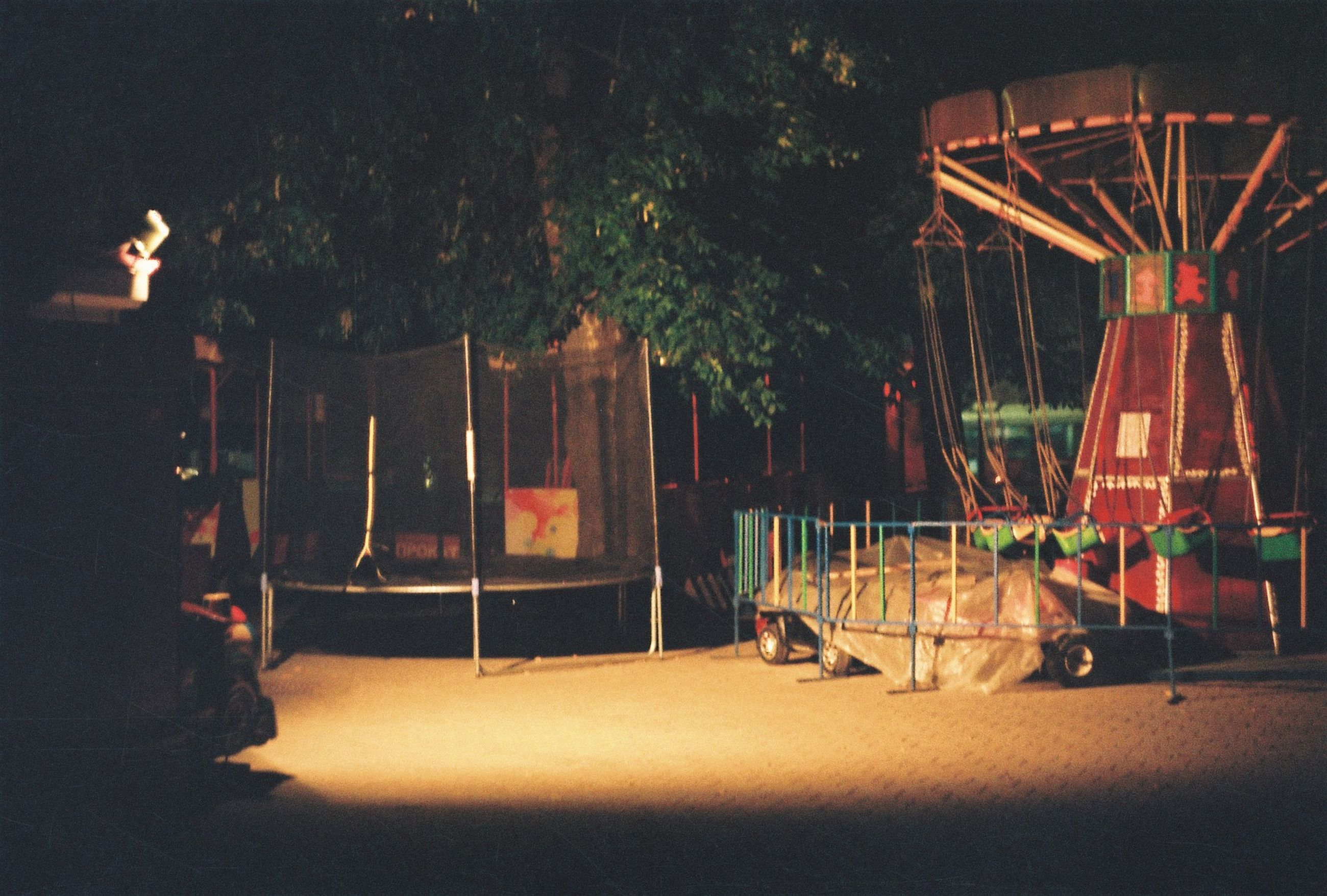arts culture and entertainment, absence, tree, no people, amusement park ride, nature, amusement park, architecture, night, outdoors, plant, empty, illuminated, playground, built structure, chair, seat, fun, enjoyment, park