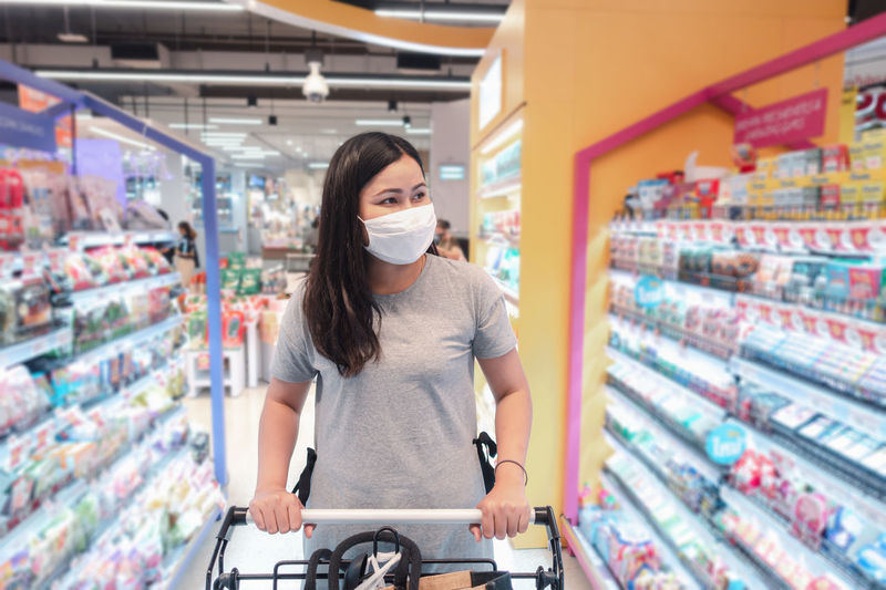 Woman wearing flu mask in store