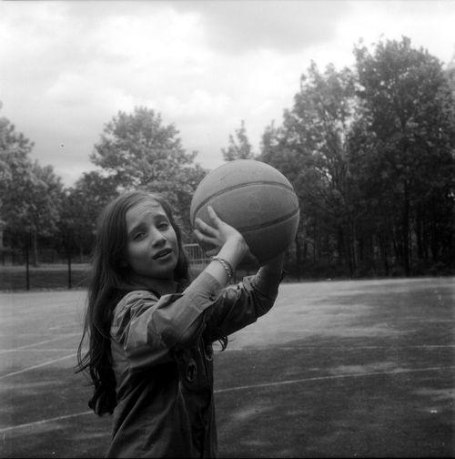 Portrait Of Girl Holding Basket Ball