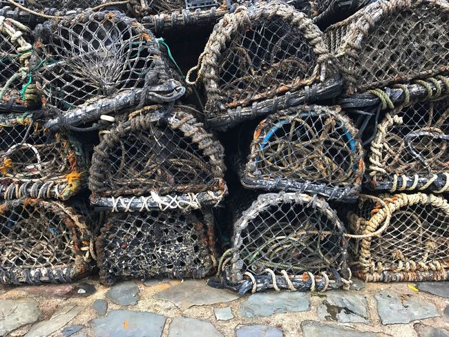 Lobster Pots Lobster Traps Fishing Harbour Harbor Harbourside Street Streetphotography Fishing Village Street Photography Large Group Of Objects Arrangement Fishing Equipment No People Fishing Net