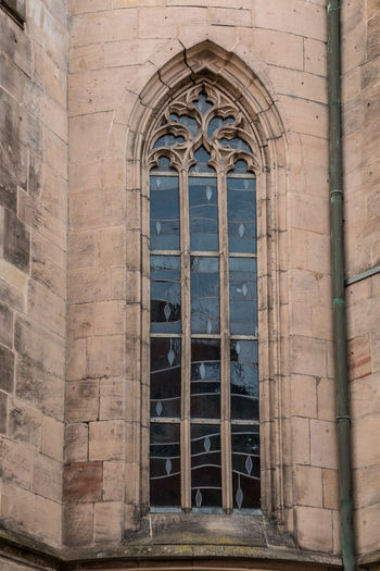 Window of an old historical building Architecture Built Structure Building Exterior Building Arch Window History The Past Old Entrance Day Door Closed Place Of Worship No People Religion Belief Spirituality Outdoors Glass Stone Wall