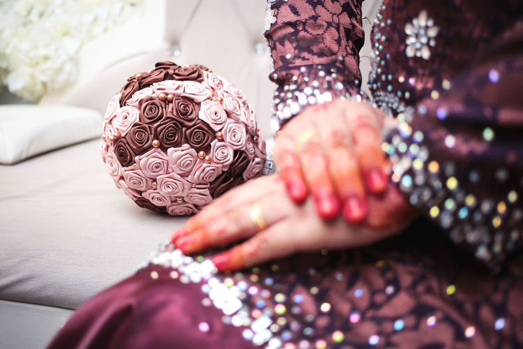 Midsection of bride during wedding