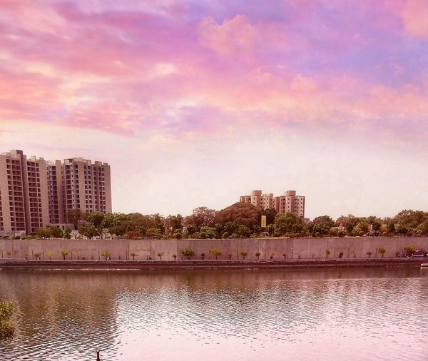 scenic view of sabarmati ashram river front City Water Urban Skyline Sunset Tree Cityscape Lake Reflection Sky Architecture Reflecting Pool Storm Cloud Pastel Colored Mausoleum Thunderstorm Puddle Lightning Cumulonimbus Pale Pink Pixelated Romantic Sky Forked Lightning Storm Tornado Overcast Sky Only Standing Water Hurricane - Storm Rainy Season Reflection Lake