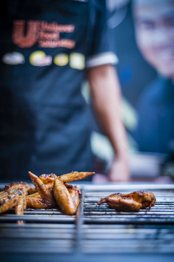 Close-up of chicken meat on barbecue grill