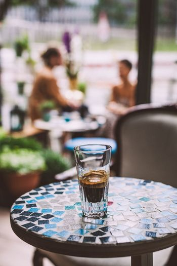 Close-up of espresso in glass on table