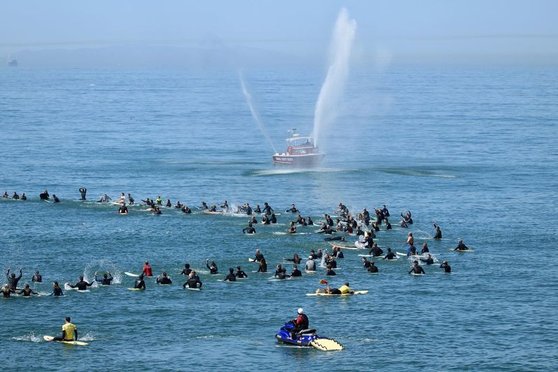Memorial paddle out for a surfer that passed away Circle Many People Paddle Out Rest In Peace Surfer Beauty In Nature Day Funeral Group Of People In Honor Of Nature Outdoors Rememberance Sea Sky Surfing Lifestyle Water