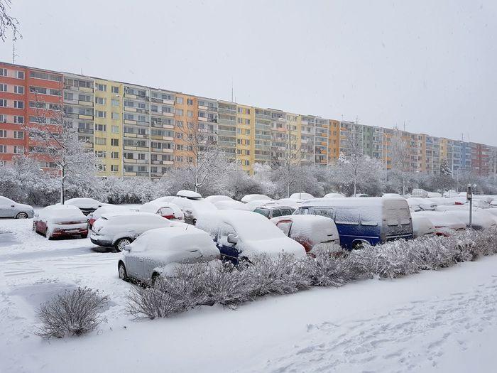 Snow covered car against sky