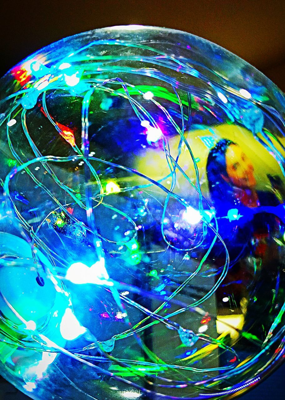 multi colored, close-up, sphere, blue, no people, indoors, glass - material, transparent, illuminated, reflection, still life, bubble, shiny, vulnerability, fragility, ball, nature, focus on foreground, single object, glowing