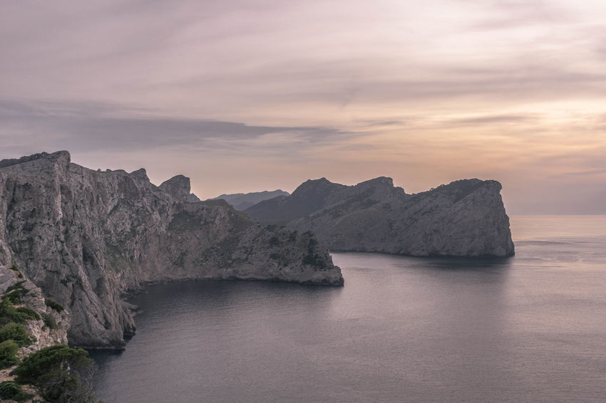 Purple day at Cap De Formentor in Mallorca , Illes Balears Beauty In Nature Cliff Cloud - Sky Idyllic Landscape Landscape_Collection Mediterranean Sea Mountain Nature Physical Geography Rock Rock Formation Scenics Sea Sky Tranquil Scene Water