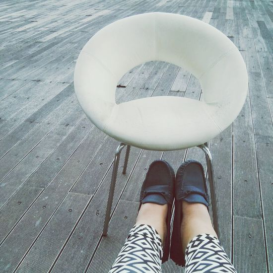 Try reaching, forcing, but failed. White Chair Loafers Pattern Wooden Floor