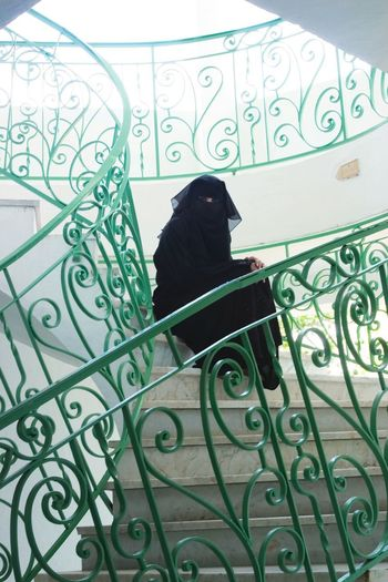 Woman Sitting in Staircase Middle East Tunisia Abaya Hijab Middle Eastern Woman Sitting Alone Staircase Women Around The World Women Portraits