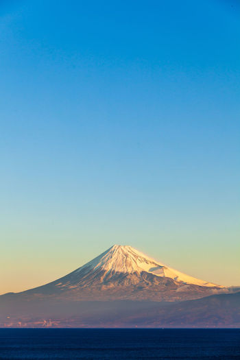 Scenic view of sea and mt.fuji  against blue sky