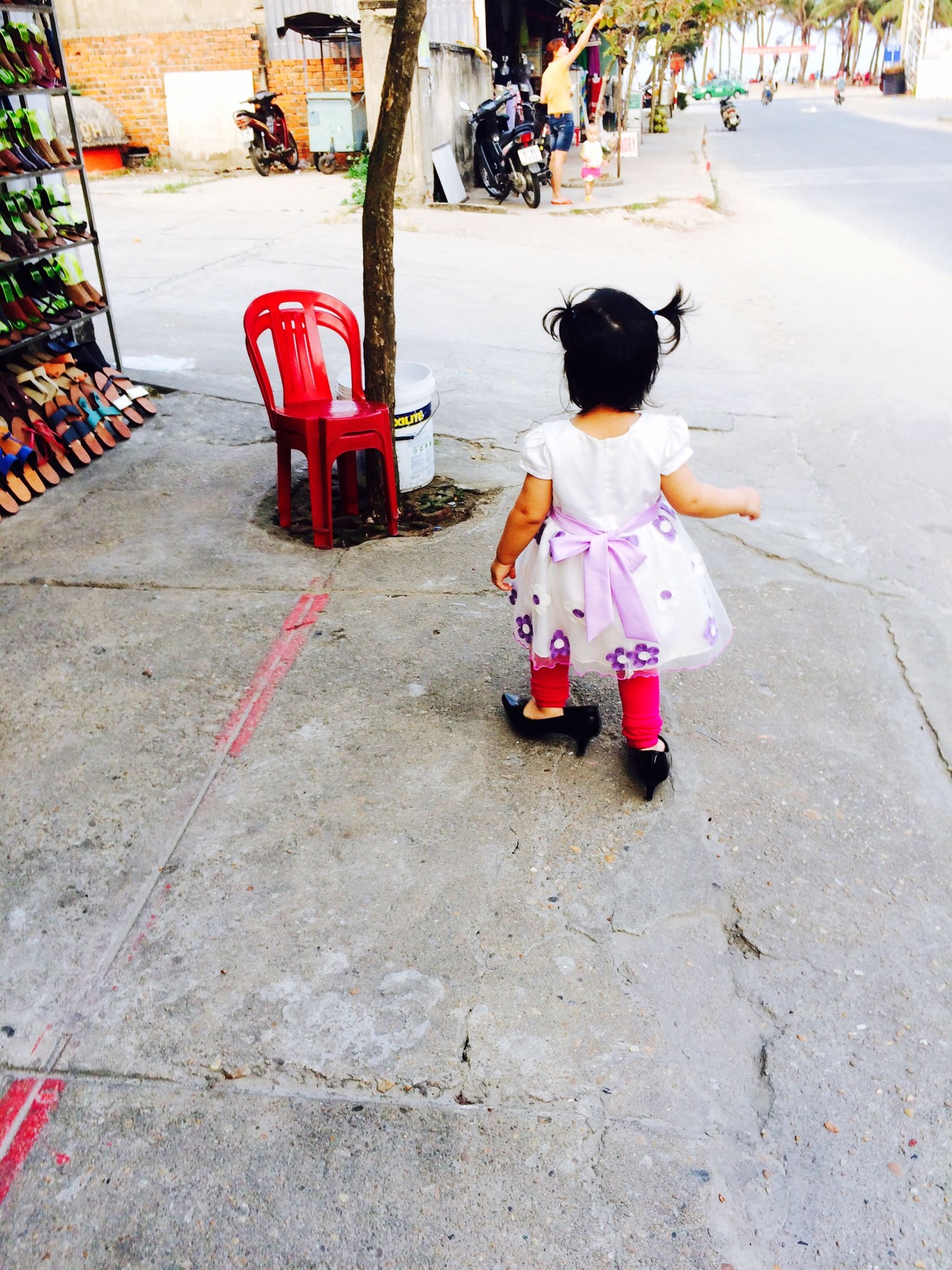childhood, street, full length, boys, lifestyles, day, elementary age, girls, casual clothing, high angle view, outdoors, sitting, road, footpath, incidental people, leisure activity, sidewalk, toy, innocence