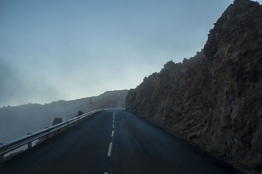 Road to El Teide vulcan mountain scene in winter Asphalt El Teide National Parc Travel Beauty In Nature Blue Sky Clear Sky Day Diminishing Perspective Landscape Mountain Mountain Range Nature No People Outdoors Road Road Marking Scenics Silence Sky Solitude The Way Forward Transportation Vacation White Line