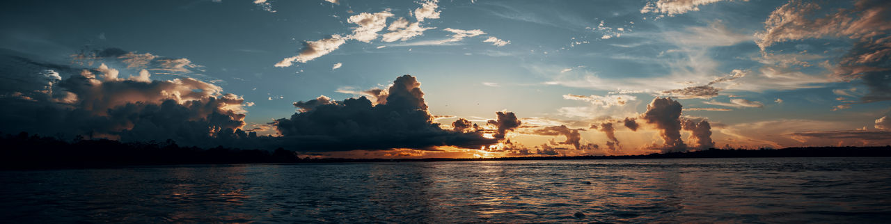 Amazonian sunset. Amazon Amazonas Rainforest Jungle South America Latin America Sky Cloud - Sky Sunset Water Reflection Reflections In The Water Rippled Sun Moody Boat Outdoors Nature Tranquility Non-urban Scene Waterfront Silhouette Gradient Adventure No People