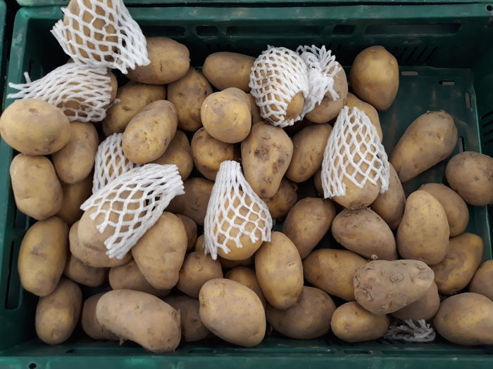 High angle view of raw potatoes for sale at market stall