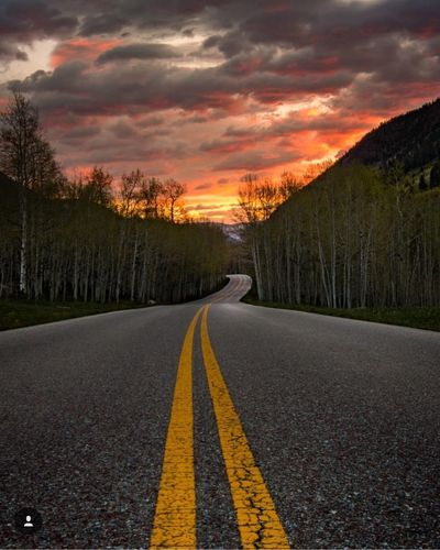 Road Transportation Sunset Road Marking The Way Forward Tree Orange Color Tranquil Scene Diminishing Perspective Empty Cloud - Sky Double Yellow Line Scenics Sky Tranquility Country Road Dividing Line Empty Road Surface Level Beauty In Nature