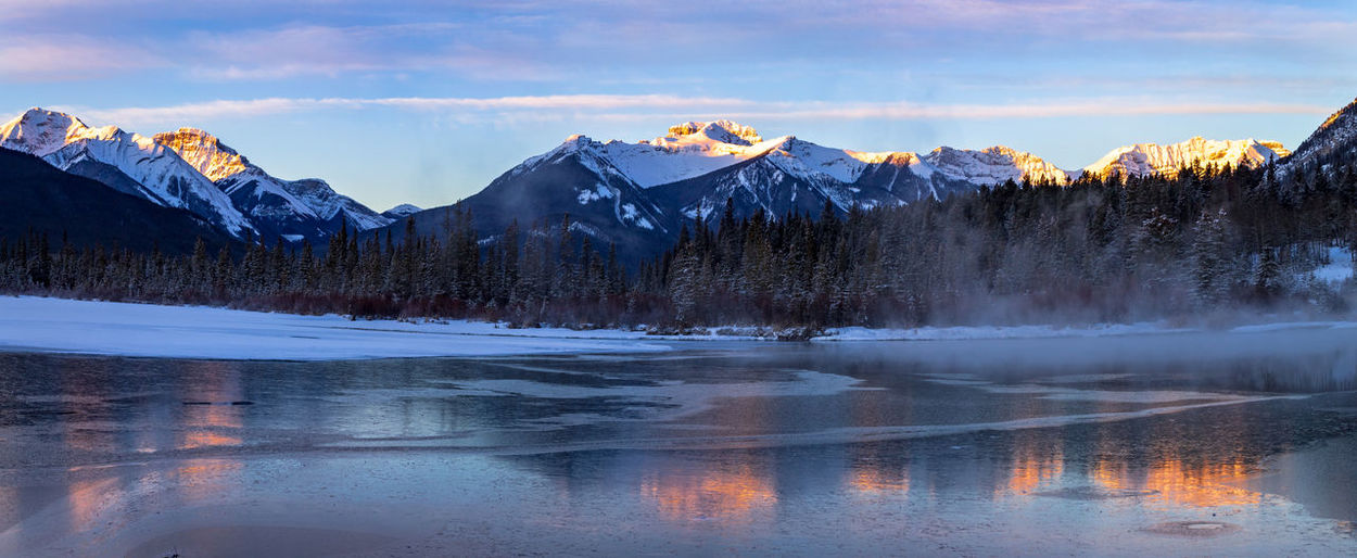 Water Scenics - Nature Sky Beauty In Nature Lake Cold Temperature Mountain Snow Winter Nature Tranquil Scene Tranquility Cloud - Sky No People Mountain Range Snowcapped Mountain Banff National Park  Banff