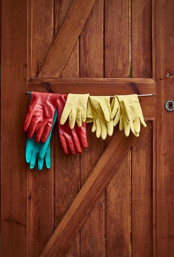 Gloves Hanging On Wooden Door