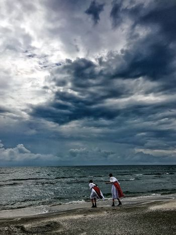 Enjoy The New Normal Sea Sky Cloud - Sky Two People Beach Real People Horizon Over Water Water Nature Outdoors Leisure Activity Togetherness Full Length Beauty In Nature Men Lifestyles Day Scenics Tranquil Scene Sand