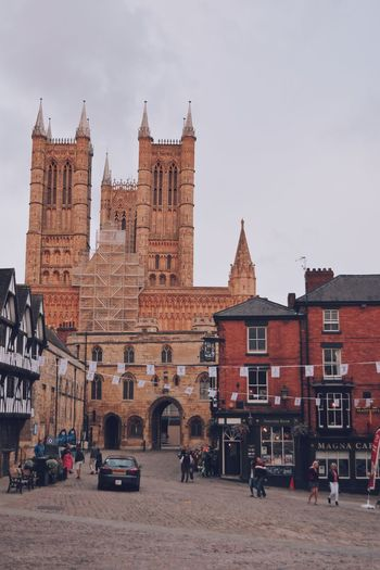 Street of Lincoln Architecture Building Exterior Built Structure Building Sky City Mode Of Transportation Incidental People Nature Land Vehicle Car Motor Vehicle Transportation Real People History Group Of People The Past Travel Destinations Day Place Of Worship