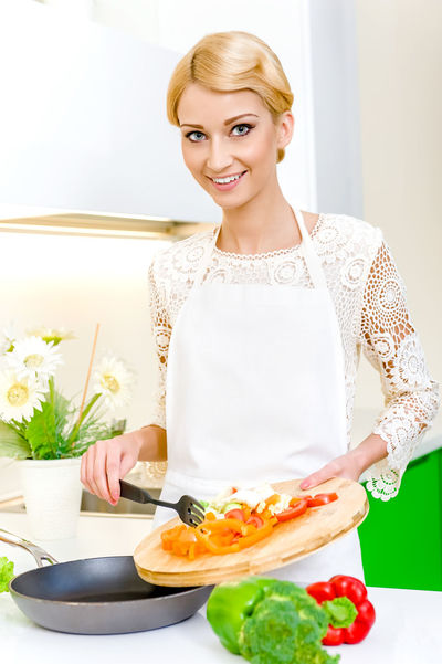 Young woman cooking. Healthy Food. Dieting Concept. Healthy Lifestyle. Cooking At Home. Apron Attractive Beautiful Woman Blond Hair Caucasian Cooking Diet Dieting Food Food And Drink Food Preparation Healthy Eating Healthy Lifestyle Home Interior Indoors  Kitchen One Person One Young Woman Only Portrait Preparation  Vegetables Vegetarian Vegetarian Food Woman Young Women