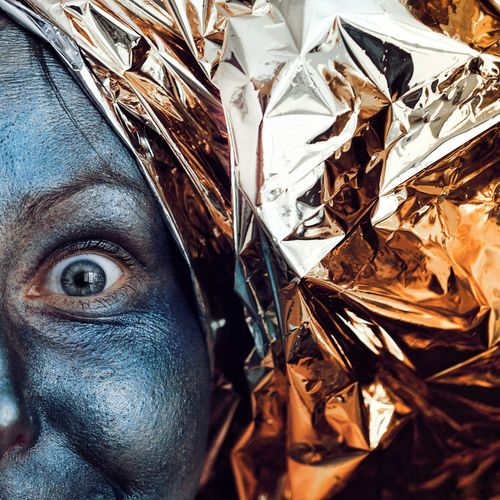 Close-up of painted face woman with wrapping paper
