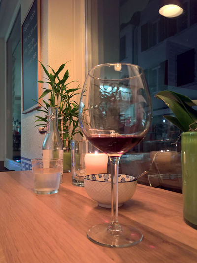 Relaxing Romantic Alcohol Business Drink Drinking Glass End Of Working Day Food Food And Drink Freshness Glass Glass - Material Household Equipment Indoors  No People Red Wine Refreshment Restaurant Still Life Table Transparent Wine Wineglass Wood - Material