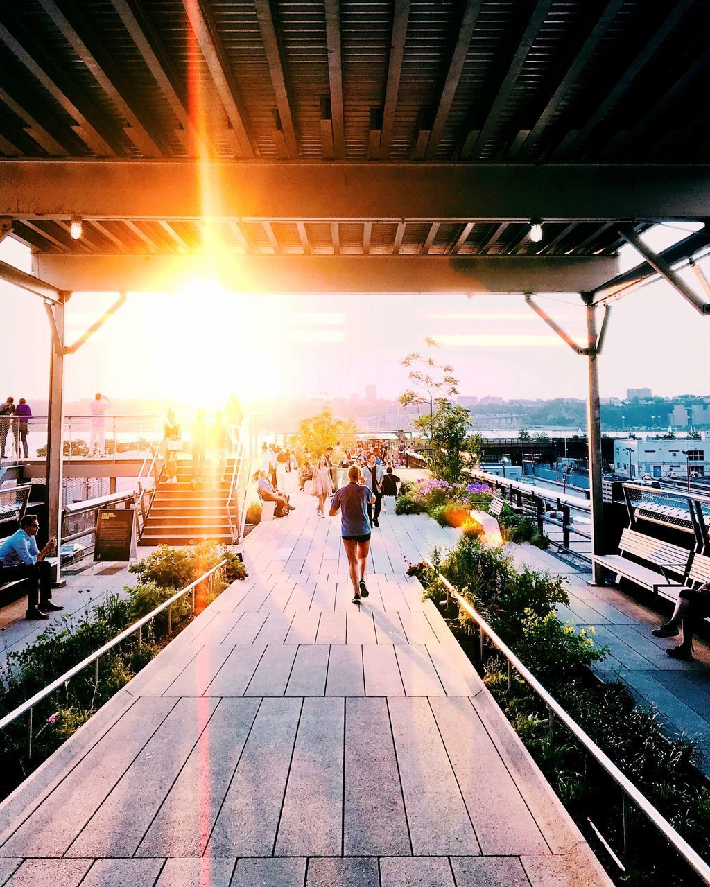 architecture, built structure, sky, sunlight, real people, lifestyles, water, nature, building exterior, lens flare, leisure activity, day, men, adult, sunset, group of people, outdoors, rear view, women, sun