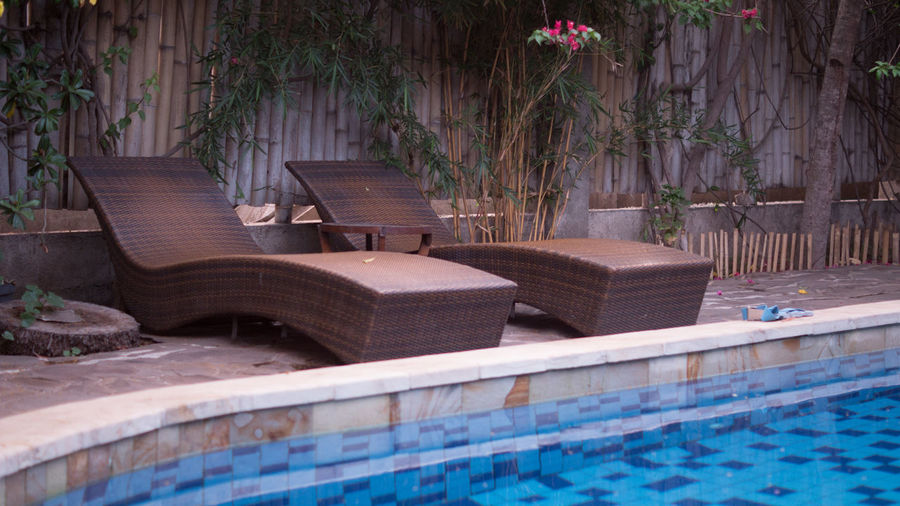 Relax! Rattan Relaxing Day Front Or Back Yard Indoors  No People Plant Relax Sun Deck Sundeck Swimming Pool