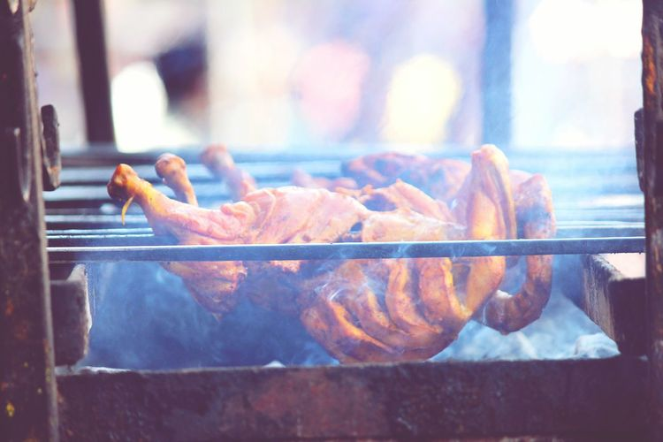 Chicken being grilled on barbecue
