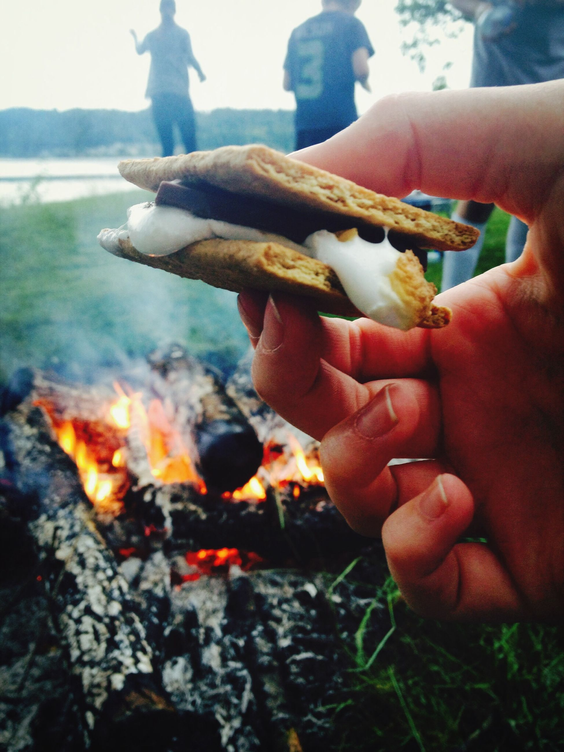 person, holding, part of, cropped, human finger, unrecognizable person, men, animal themes, food and drink, lifestyles, leisure activity, food, fish, close-up, one animal, water, personal perspective