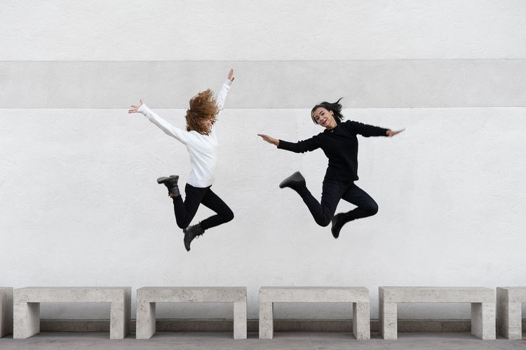Jump Architecture Sisters Two People Twins Friendship Young Women Full Length Togetherness Jumping Mid-air Women Motion Skill  Vitality Flexibility Acrobatic Activity 50 Ways Of Seeing: Gratitude #NotYourCliche Love Letter