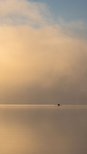 Lonesome fisherman on a misty lake at the break of dawn. Fujifilm X-H1 Misty Rowing Boat Schleswig-Holstein Beauty In Nature Cloud - Sky Day Distant Fisherman Horizon Horizon Over Water Idyllic Nature Nautical Vessel No People Outdoors Salt Flat Scenics - Nature Sea Sky Tranquil Scene Tranquility Water Waterfront Windless #FREIHEITBERLIN
