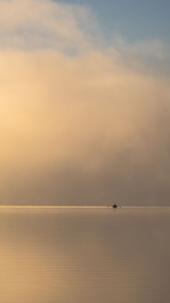 Lonesome fisherman on a misty lake at the break of dawn. Fujifilm X-H1 Misty Rowing Boat Schleswig-Holstein Beauty In Nature Cloud - Sky Day Distant Fisherman Horizon Horizon Over Water Idyllic Nature Nautical Vessel No People Outdoors Salt Flat Scenics - Nature Sea Sky Tranquil Scene Tranquility Water Waterfront Windless #FREIHEITBERLIN Capture Tomorrow