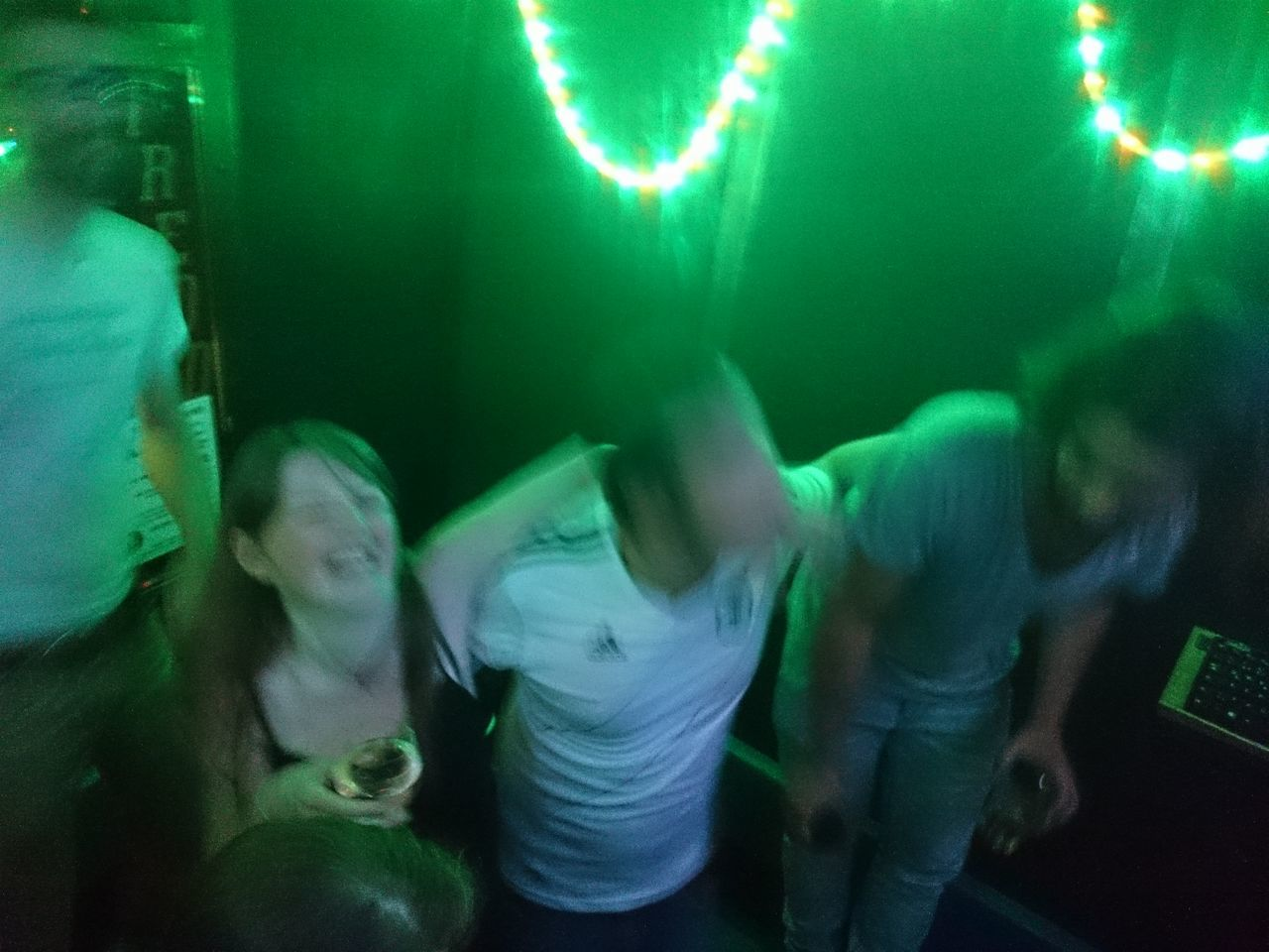 illuminated, green color, night, indoors, real people, nightlife, young adult, nightclub, close-up, one person, people