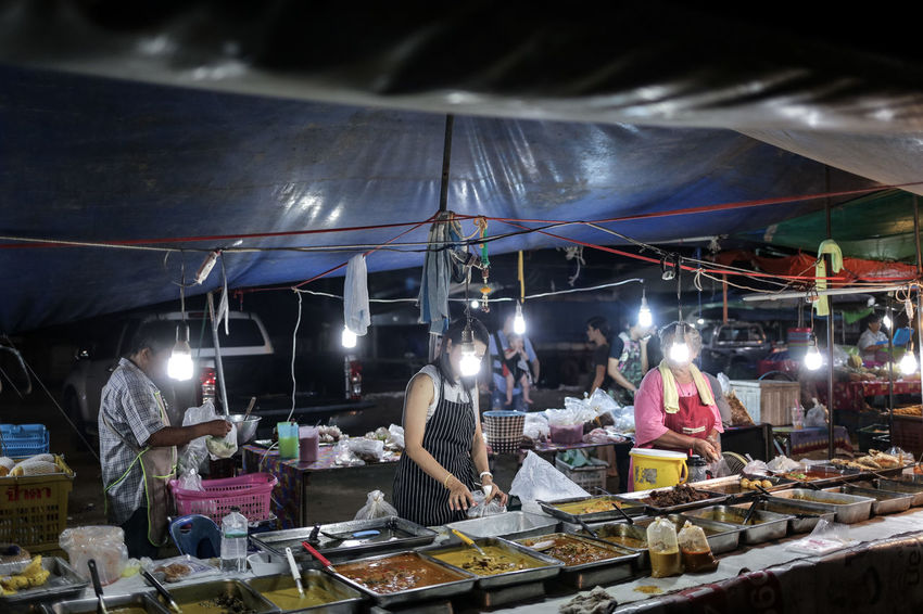 Night market in Phuket, Thailand Enlightenment Food Stall Illuminated Local Market Market Night Night Market No Faces Real People Small Business South East Asia Street Food Street Photo Street Photography Streetphoto The Street Photographer - 2017 EyeEm Awards Thai Food Thailand Tourism Travel Photography UNPOSED Working