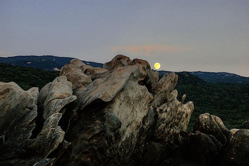 Rocks on mountain against clear sky