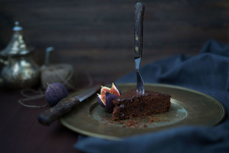 chocolate cake with figs Chocolate Cake Close-up Dessert Eating Utensil Focus On Foreground Food Food And Drink Freshness Indoors  Indulgence Kitchen Utensil No People Plate Purple Ready-to-eat Selective Focus Still Life Sweet Sweet Food Table Temptation Wood - Material