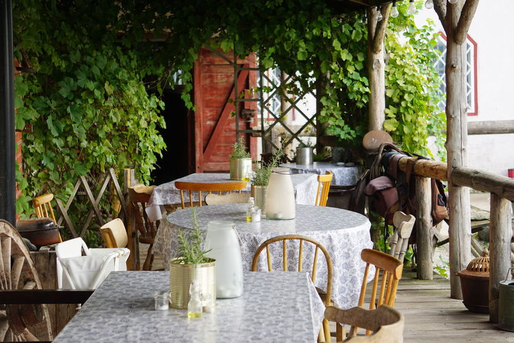 Chairs and tables at outdoor restaurant